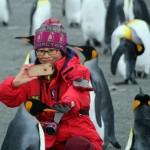 Pasajera china y pingüino rey