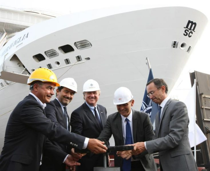 MSC Cruises executives, Mr Pierfrancesco Vago and Mr Gianni Onorato, open the valve with STX Director